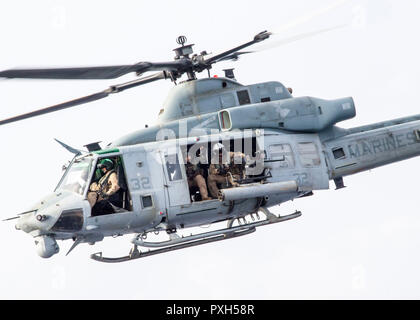 181017-N-PH222-1088 MEDITERRANEAN SEA (Oct. 17, 2018) A UH-1Y Venom helicopter attached to Marine Medium Tiltrotor Squadron (VMM) 166 (Reinforced), conducts flight operations from the San Antonio-class amphibious transport dock ship USS Anchorage (LPD 23) in the Mediterranean Sea, Oct. 17, 2018. Anchorage and embarked 13th Marine Expeditionary Unit are deployed to the U.S. 6th Fleet area of operations as a crisis response force in support of regional partners as well as to promote U.S. national security interests in Europe and Africa. (U.S. Navy photo by Mass Communication Specialist 3rd Class - Stock Photo