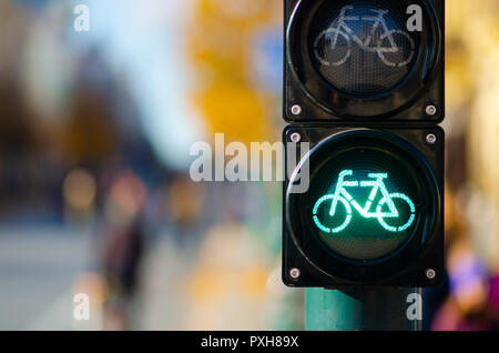 Bicycle traffic signal, green light, road bike, free bike zone or area, bike sharing - Stock Photo