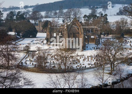 Winter view of Bolton Priory and the River Wharfe after snow - Stock Photo