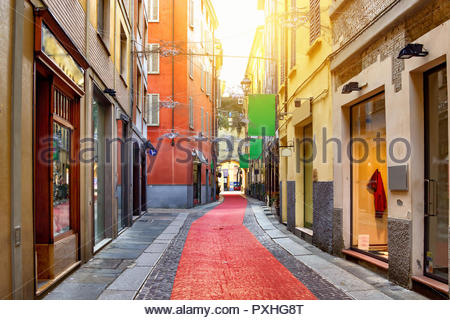 Old colorful street with shops in Parma, Emilia-Romagna, Italy - Stock Photo