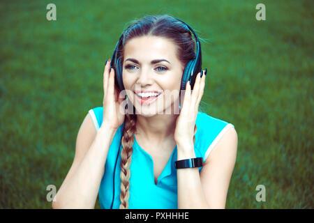 Beautiful sportive woman in headphones - Stock Photo