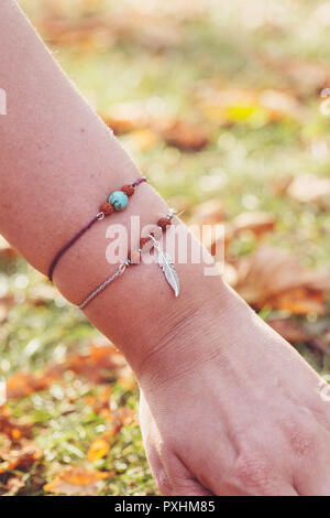 Female wrist with jewelry - Stock Photo
