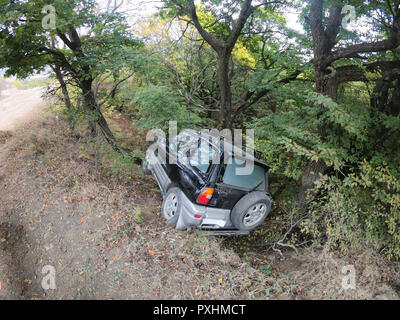 The SUV car crashed off the road in Georgian mountains - Stock Photo