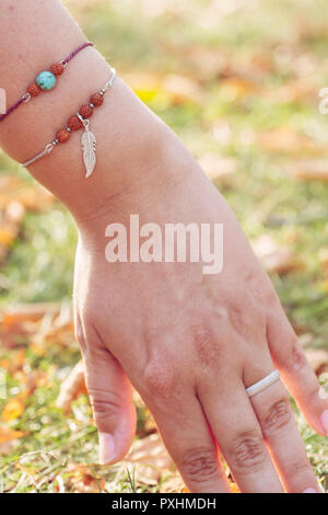 Female hand with fashionable stylish bracelets - Stock Photo