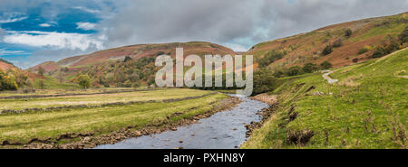 Yorkshire Dales National Park panoramic autumn landscape, the River Swale looking upstream towards Keld on the Coast to Coast long distance footpath,  - Stock Photo
