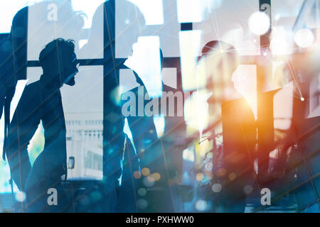 Businessmen that work together in office. Concept of teamwork, partnership and startup. double exposure - Stock Photo