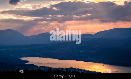 Evening view from observation tower Pyramidenkogel to mountains and lake Woerth,Carinthia,Austria - Stock Photo