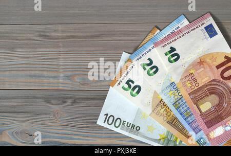 money euro euros bill banknotes save expenses earnings - Stock Photo