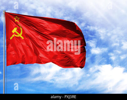 National flag of USSR on a flagpole in front of blue sky. - Stock Photo