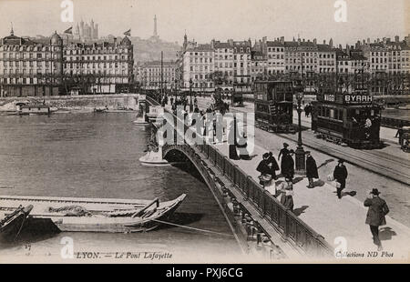 Lyon, France - Le Pont Lafayette. View over the River Rhone toward Fourviere Hill and Basilique Notre Dame de Fourviere in the distance.     Date: circa 1908 - Stock Photo