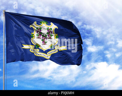 flag State of Connecticut on a flagpole in front of blue sky. - Stock Photo