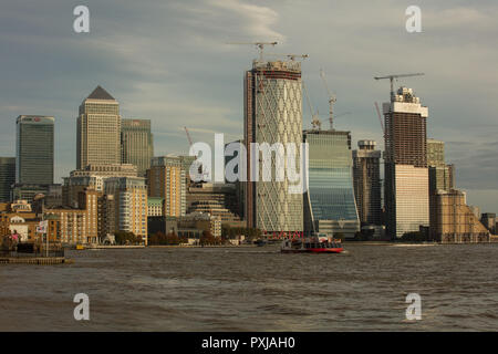 View from Limehouse Basin, London, UK, towards Isle of Dogs and Canary Wharf over the river Thames on a Saturday middle of October 2018 late afternoon - Stock Photo