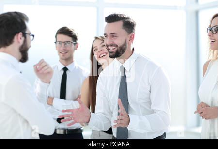 business colleagues discussing new ideas while standing in the o - Stock Photo