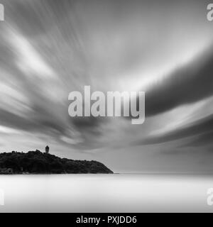 Black and white long exposure of the sea on a cloudy day, Enoshima, Japan - Stock Photo
