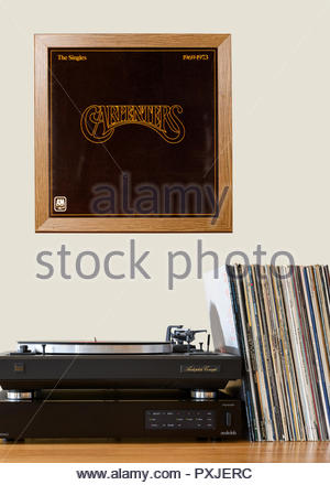 Record player and framed album cover The Carpenters album The Singles 1969-1973, England - Stock Photo
