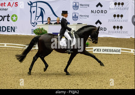Herning, Denmark. 21st October, 2018. Helen Langehanenberg of Germany riding Damsey Frh during the FEI World Cup 2018 in freestyle dressage in Denmark. Credit: OJPHOTOS/Alamy Live News - Stock Photo