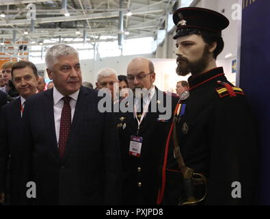 Moscow, Russia. 23rd Oct, 2018. MOSCOW, RUSSIA - OCTOBER 23, 2018: Russia's Interior Minister Vladimir Kolokoltsev (L front) visits the Interpolitex 2018 International Exhibition of Means of State Security Provision held at Moscow's VDNKh Exhibition Centre. Stanislav Krasilnikov/TASS Credit: ITAR-TASS News Agency/Alamy Live News - Stock Photo