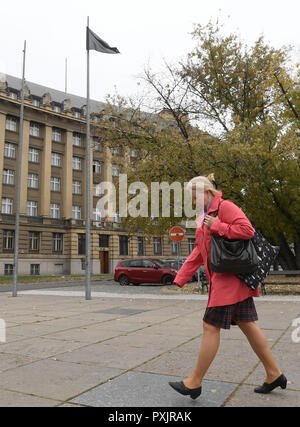 A woman pass a black flag flying at mast in front of the General Staff of Czech Armed Forces seat. The Czech soldier who died in Afghanistan on Monday was killed by an Afghan soldier, Defence Minister Lubor Metnar and Chief of Staff Ales Opata told journalists today, on Tuesday, October 23, 2018. The body of the soldier Tomas Prochazka will be transported back to the Czech Republic on Wednesday evening, Metnar and Opata said. Another two Czech soldiers were injured, but their lives are not endangered.  (CTK Photo/Ondrej Deml) - Stock Photo