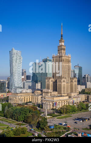 Warsaw Centrum, view of the very heart of the polish capital, with the Neomodern Warsaw Spire and the Russian Weding Cake style soc-realist Palace of  - Stock Photo