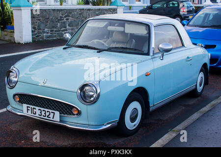11 October 2018 A Classis Nissan Figaro automatic convertible car with mint chrome trim parked on the Seacliff Road in Bangor County Down Northern Ire - Stock Photo