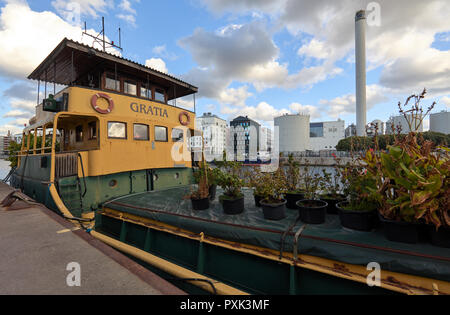 Old privat boat Gratia with a lot of plants on it near Skanstull, Stockholm, Sweden - Stock Photo