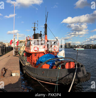 Old red-black industrial boat in Hammarby sea, Stockholm, Sweden - Stock Photo