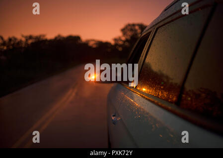 4WD car parking along the road during twilight. Travel concept, luxury lifestyle. Panama, Central America. RF - Oct 2018 - Stock Photo