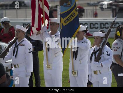 Millington, TN (June 03, 2017) Color guard members stationed onboard NSA Mid-South carry colors before the national anthem at the start of the NASCAR race at Memphis International Raceway.