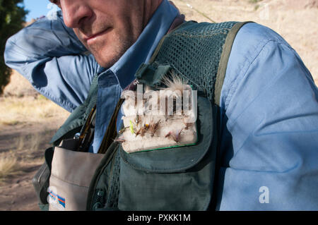 Trout fishing using a fly bait is hand made as one of the trends of the Patagonian region of lakes - Stock Photo