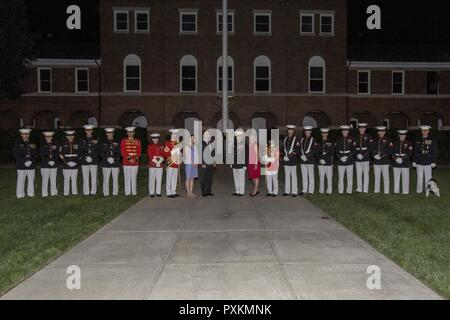 Secretary of the Navy the Honorable Sean J. Stackley, center left, and the Commandant of the Marine Corps Gen. Robert B. Neller, center right, pose for a photo with U.S. Marines from Marine Barracks Washington following an evening parade at Marine Barracks Washington, Washington, D.C., June 9, 2017. Evening parades are held as a means of honoring senior officials, distinguished citizens and supporters of the Marine Corps. - Stock Photo