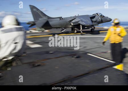 An AV-8B Harrier short take off-vertical landing jet launches down the flight deck during deck qualifications in the Pacific Ocean aboard the USS Bonhomme Richard (LHD 6), June 14, 2017. VMA-311 and Marine Medium Tiltrotor Squadron 265 (Reinforced) combine to form the Aviation Combat Element of the 31st Marine Expeditionary Unit. The 31st MEU partners with the Navy's Amphibious Squadron 11 to form the amphibious component of the Bonhomme Richard Expeditionary Strike Group. The 31st MEU and PHIBRON 11 combine to provide a cohesive blue-green team capable of accomplishing a variety of missions a - Stock Photo