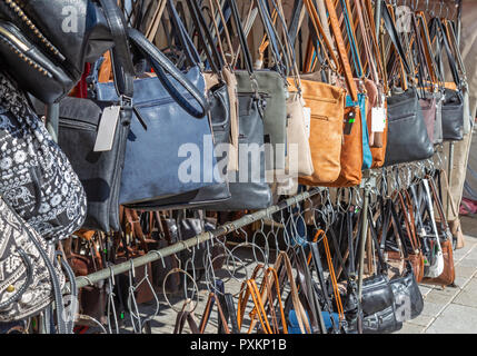 Handbags for sale at a market stall in Germany - Stock Photo