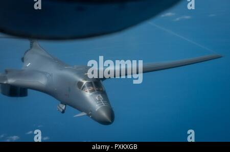 A U.S. Air Force B-1B Lancer assigned to the 9th Expeditionary Bomb Squadron, deployed from Dyess Air Force Base, Texas, flies a 10-hour mission from Andersen Air Force Base, Guam, through the South China Sea, operating with the U.S. Navy's Arleigh Burke-class guided-missile destroyer USS Sterett (DDG 104), June 8, 2017. The joint training, organized under Pacific Command's continuous bomber presence program (CBP), allows the Air Force and Navy to increase interoperability by refining joint tactics, techniques and procedures while simultaneously strengthening their ability to seamlessly integr - Stock Photo