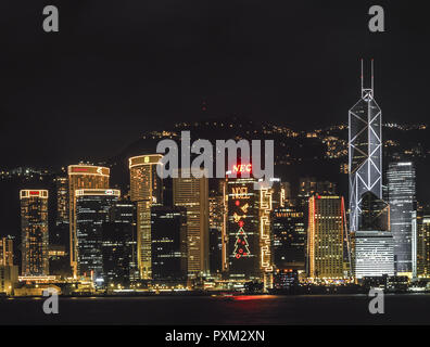 Blick auf die Skyline von Hong Kong bei Nacht, View of the skyline of Hong Kong at night, Architecture, Asia, Asian, Buildings, Building, Lighting, Il - Stock Photo