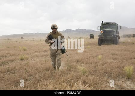 DUGWAY PROVING GROUNDS, Utah – Pfc. Carlos R. Rodriguez a field operator with Battery D, 2nd Battalion, 14th Marine Regiment, 4th Marine Division, Marine Forces Reserve, provides ground guidance at Dugway Proving Grounds, Utah, June 12, 2017. Marines with Battery D, are conducting their two-week annual training at to maintain unit readiness and enhance combat proficiencies. - Stock Photo