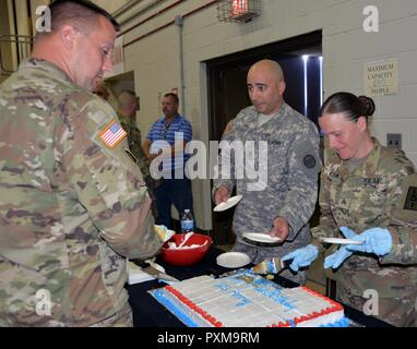 New York Army National Guard Soldiers enjoy birthday cake during Army Birthday ceremonies at New York National Guard Headquarters in Latham, N.Y. on June 14, 2017. New York Army National Guard members celebrated the 242nd Birthday of the United States Army. - Stock Photo