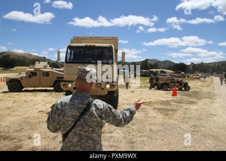 U. S. Army sgt. 1st class david avilla (front), spc. Jeremy pambrun.