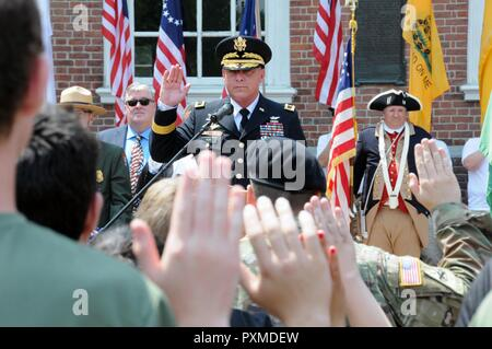 Maj. Gen. Troy D. Kok, commanding general of the U.S. Army Reserve's 99th Regional Support Command, gives the oath of enlistment June 14 to almost 50 new Army recruits during the Stripes and Stars Festival celebrating the U.S. Army 242nd birthday at Independence Hall in Philadelphia. - Stock Photo