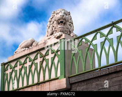 St. Petersburg, Russia, summer 2017: Pushkin city, Alexander Park, sculpture of a roaring stone lion on the facade of the White Tower complex - Stock Photo