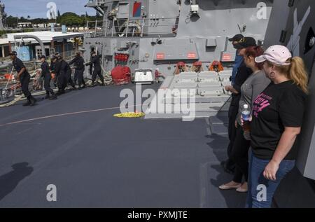 PACIFIC OCEAN (June 17, 2017) Friends and family members of crew members aboard Arleigh Burke-class guided-missile destroyer USS Wayne E. Meyer (DDG 108) observe Sailors make preparations to depart Joint Base Pearl Harbor-Hickam during a tiger cruise. The U.S. Navy has patrolled the Indo-Asia-Pacific routinely for more than 70 years promoting regional peace and security. - Stock Photo