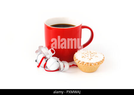 Red mug filled with black coffee ,decorated with white jingle bells, silver metallic ribbon, and a mince pie on white background. - Stock Photo