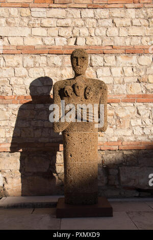 Italy, Brescia - December 24 2017: the view of Tuff Sculpture Testimoni or Witnesses by Italian artist Mimmo Paladino inside the archaeological area o - Stock Photo