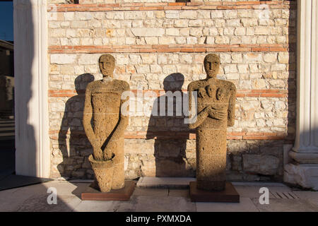 Italy, Brescia - December 24 2017: the view of Tuff Sculptures Testimoni or Witnesses by Italian artist Mimmo Paladino inside the archaeological area  - Stock Photo