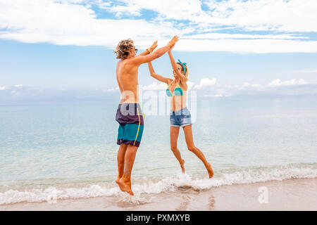 Portrait of young couple in love embracing at beach and enjoying time being together. Photo poster for advertisement banner. - Stock Photo