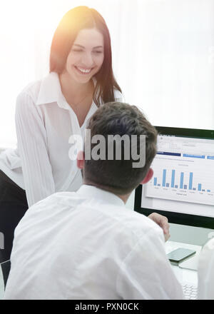 professional business team discussing marketing graphics at the desktop. - Stock Photo