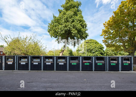 Row of recycle containers or bottle and paper bins in Crewe Cheshire UK - Stock Photo