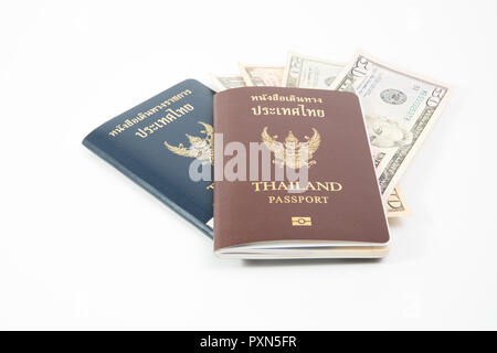 Us dollar in Thailand passport and OFFICIAL passport isolated on white background. - Stock Photo