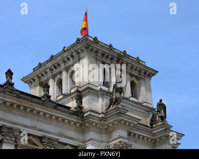 One of the top towers on The Reichstag building shows the wonderful, classical; sculpturing that adorns the grand building that is the German parliament building in Berlin. - Stock Photo