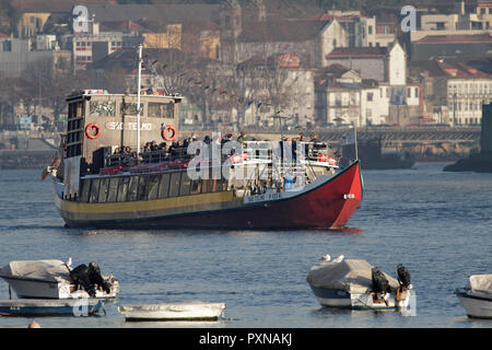 Porto, Portugal: December 5, 2018: Arrival of tourist ship after a cruise on the beautiful Douro River. - Stock Photo