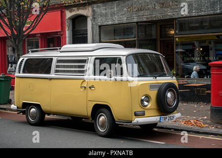 Yellow and white Volkswagen Campervan parked in Edinburgh's Old Town. - Stock Photo
